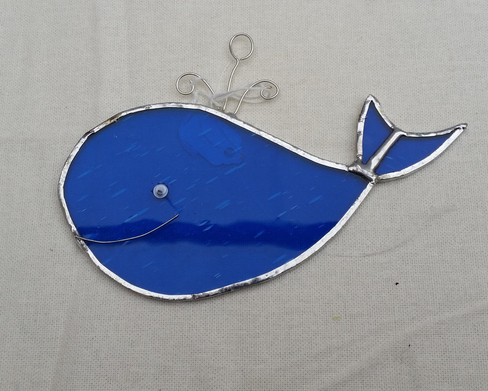 Blue stained glass whale